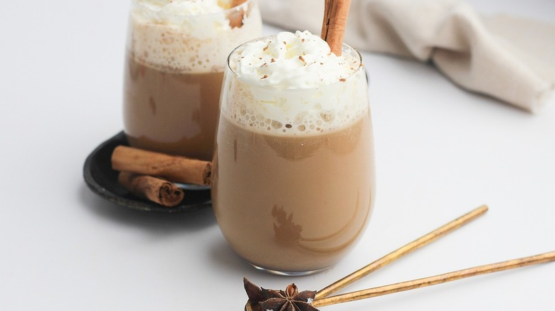 chai lattes with cinnamon sticks