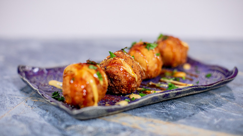Homemade hush puppies on a plate