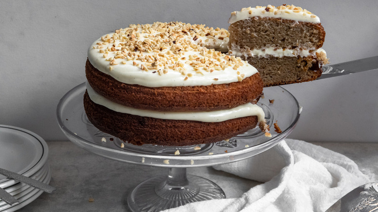 a slice of spice cake being removed from the two-layer dessert