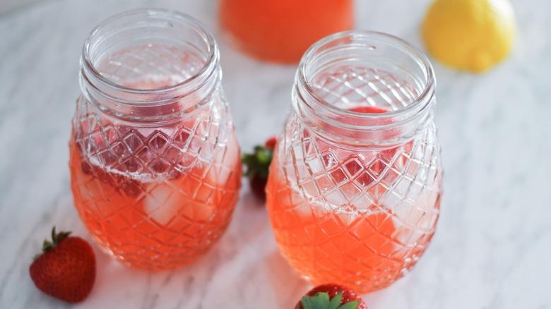 A pair of jars of strawberry lemonade