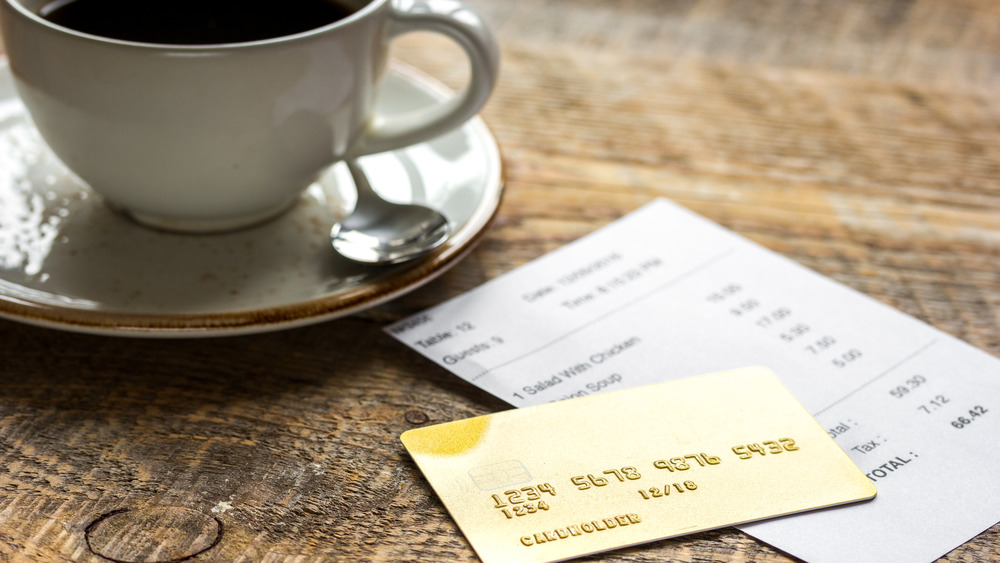 Credit card with cup of coffee