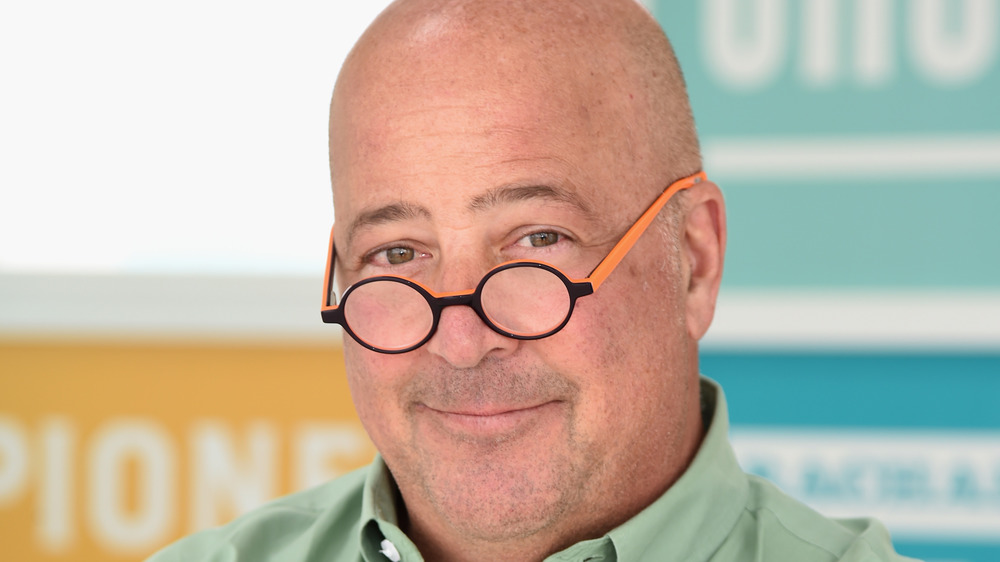 Andrew Zimmern with a half smile