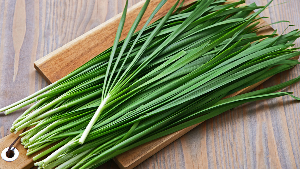Chives on cutting board
