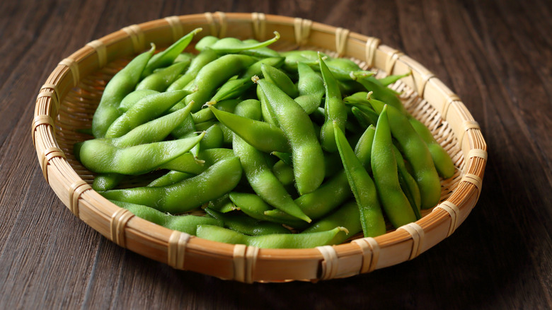 Bowl of edamame on table