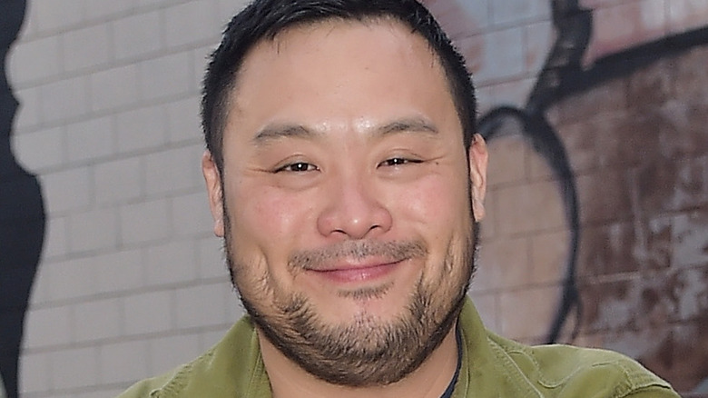 David Chang smiles in green shirt