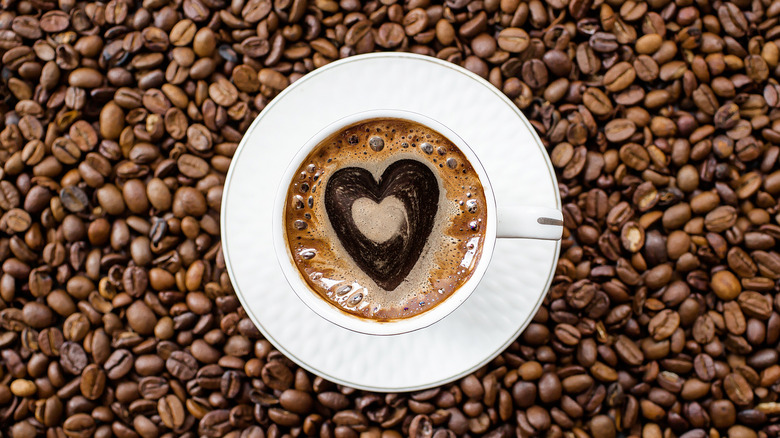 coffee beans and mug with heart