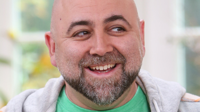 Duff Goldman in a green T-shirt and gray hoodie