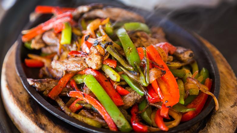 Beef fajita with peppers in pan