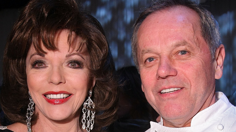 Joan Collins and Wolfgang Puck smiling
