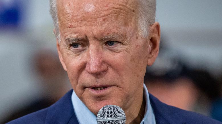 President Joe Biden with microphone