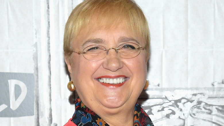 Lidia Bastianich smiles in glasses and red lipstick