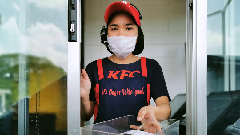KFC drive thru worker at window