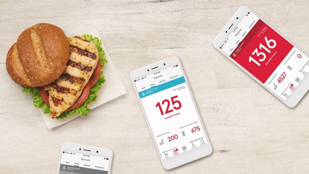 Chick-fil-A grilled chicken sandwich with rewards app open on phones