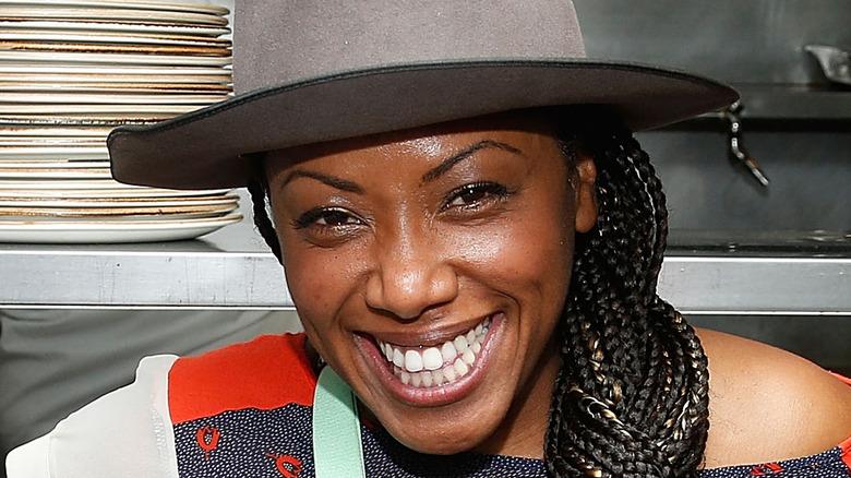 Nyesha Arrington smiling in kitchen