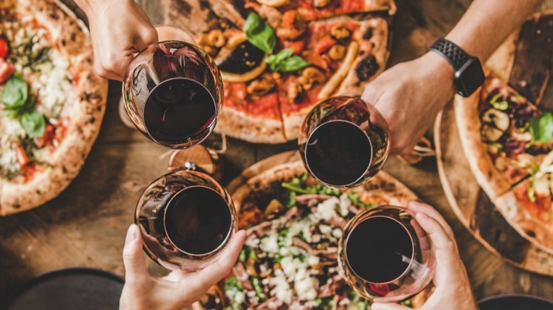 Group enjoys different pizza styles and drinks