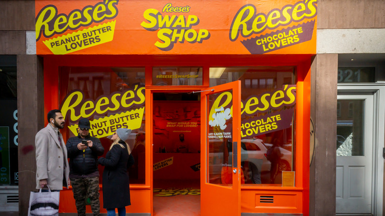 Orange and yellow storefront promoting Reese's chocolate