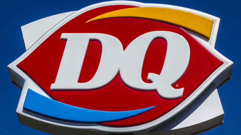 Red, white, yellow, and blue Dairy Queen logo