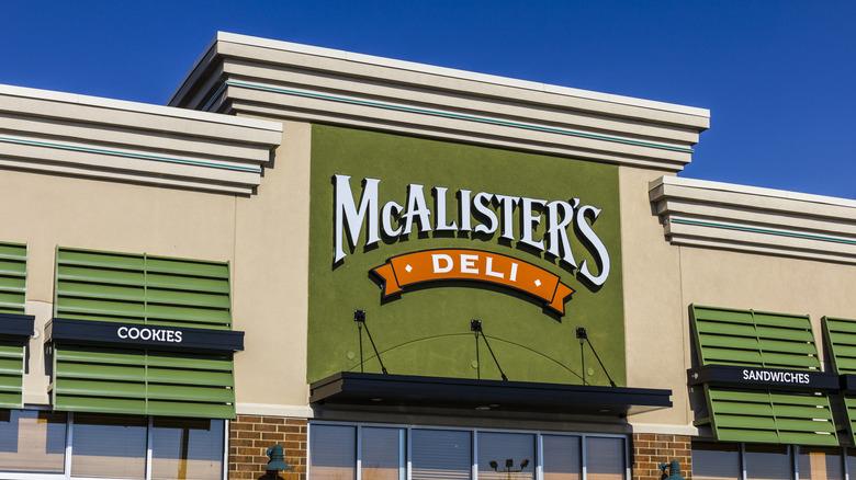 Green, white and orange McAlister's Deli logo on building