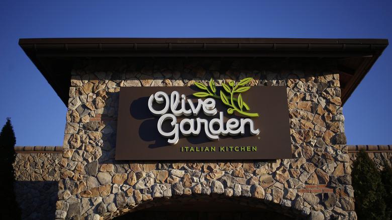 Olive Garden Italian Kitchen sign on stone building