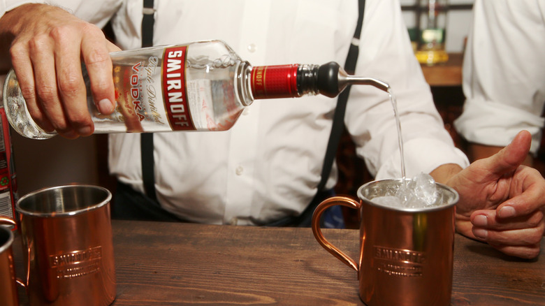 Man using Smirnoff to pour Moscow Mule