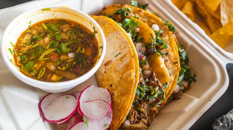 Birria tacos in container