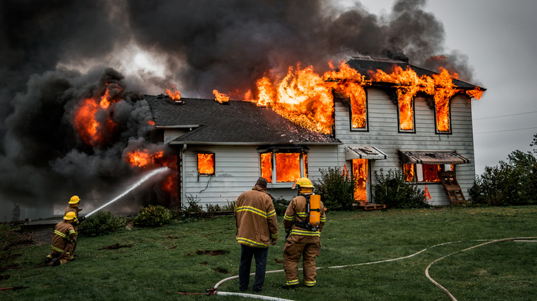 Fire fighters putting out house fire