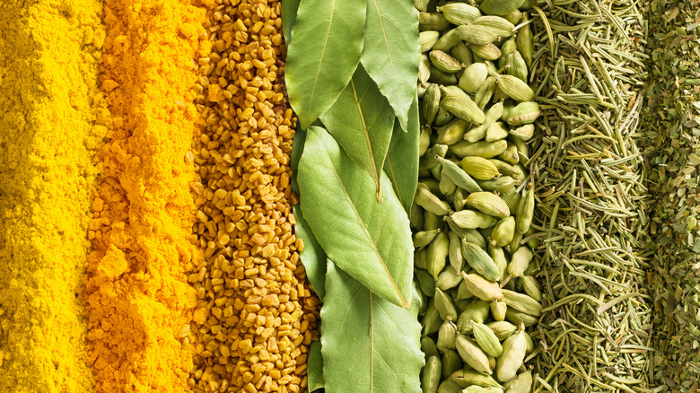Row of green and yellow spices
