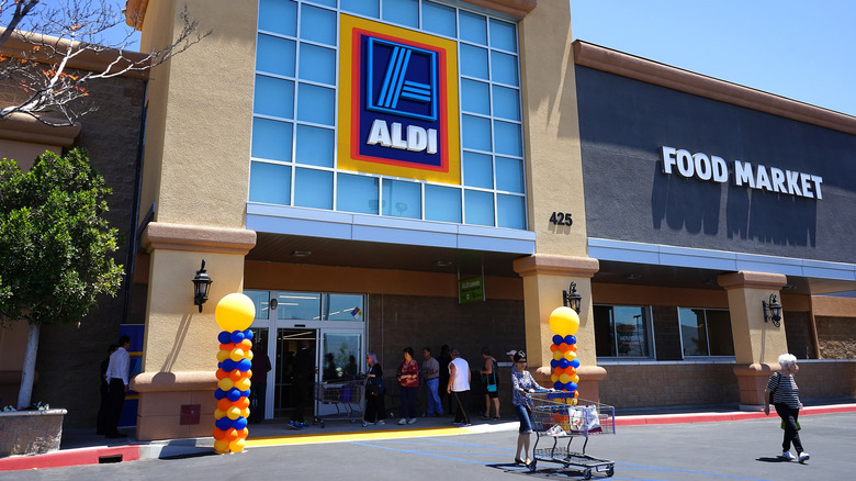 Shoppers outside Aldi store