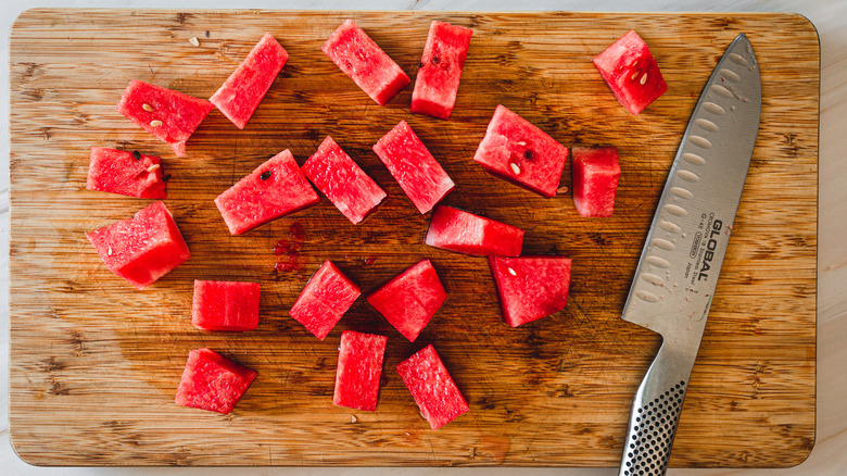 watermelon cubes and a knife