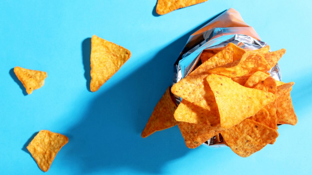 bag of potato chips on blue background
