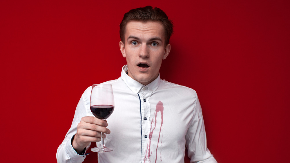Man with red wine stain in shirt