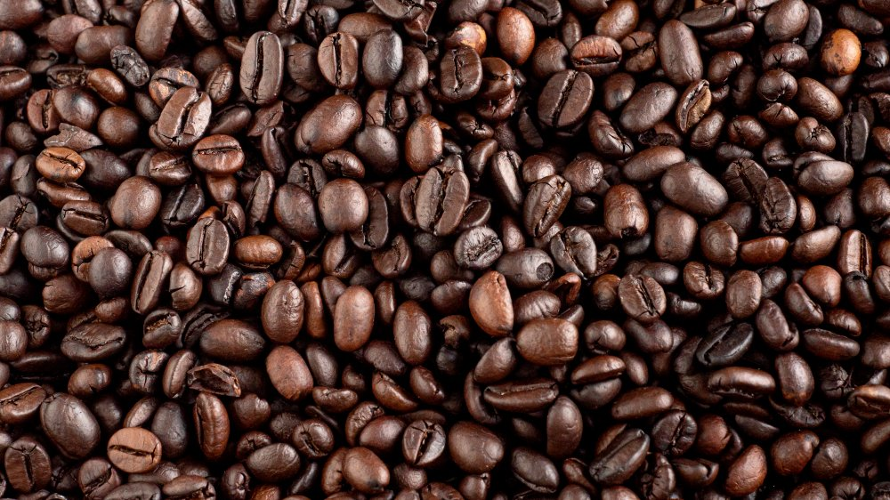 coffee beans that are shiny with oils