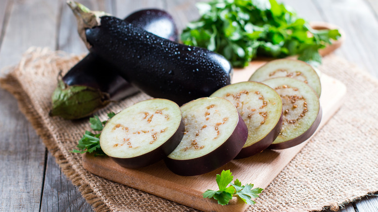 Eggplant sliced up on a board