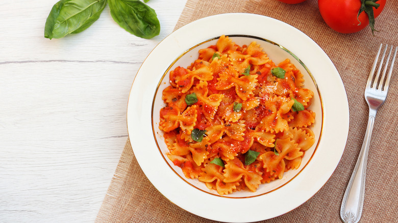 bowl of farfelle with red sauce