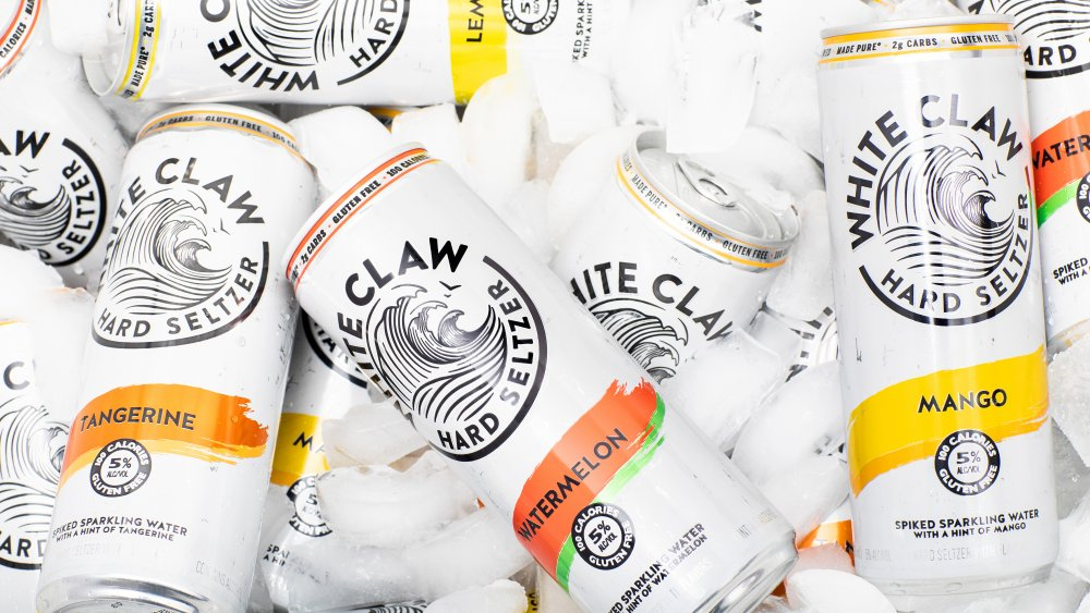 Cans of White Claw hard seltzer on ice