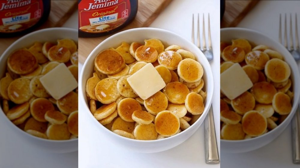 Pancake cereal with butter and syrup