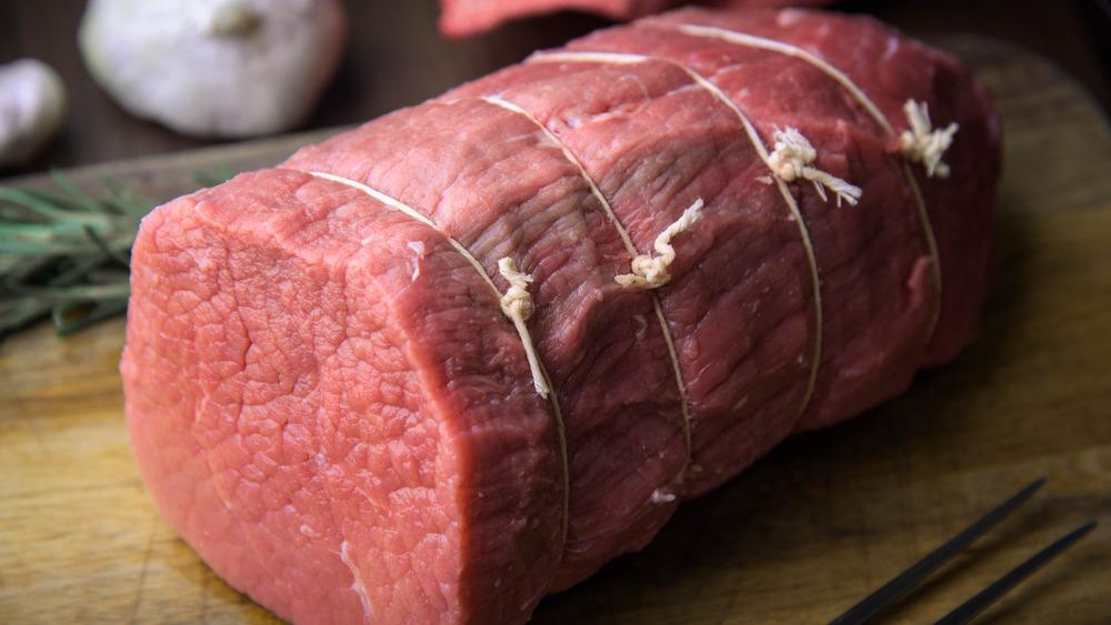 Eye of round roast on cutting board