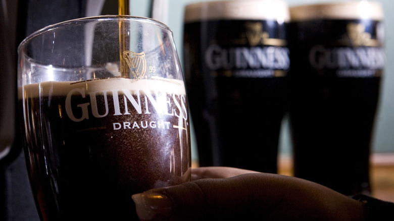 Guinness pours from a tap
