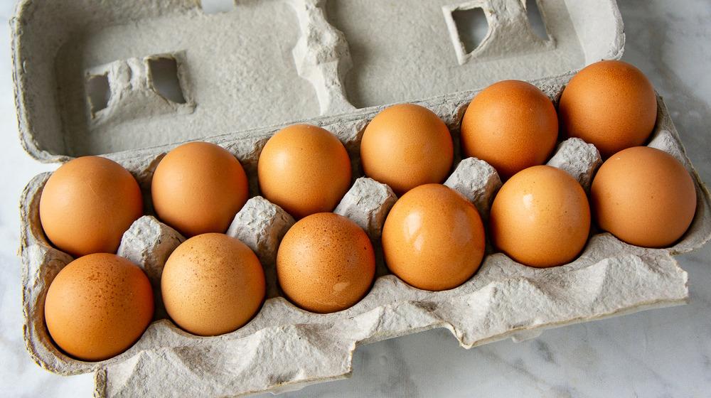 a dozen eggs in a carton