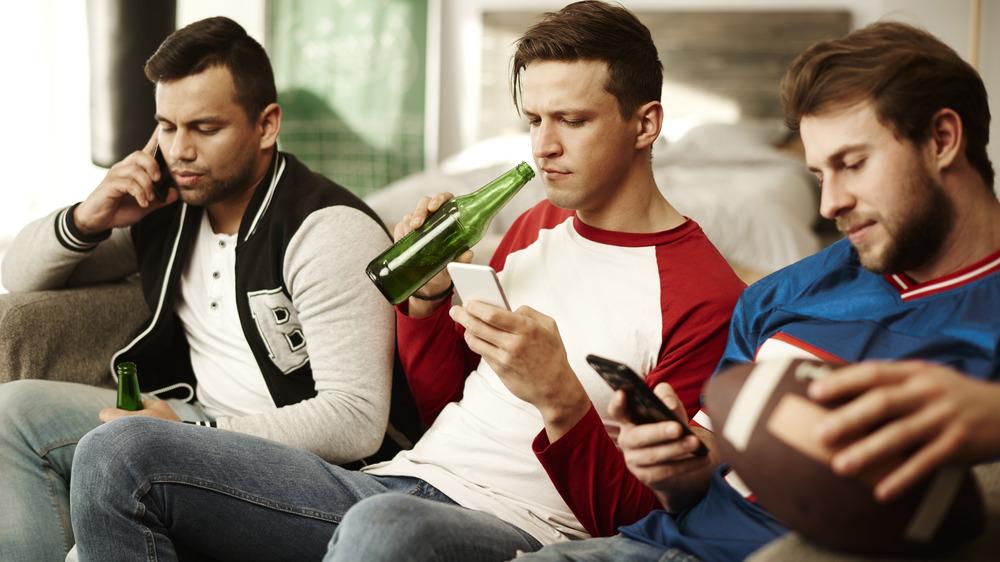 Men watch their phones