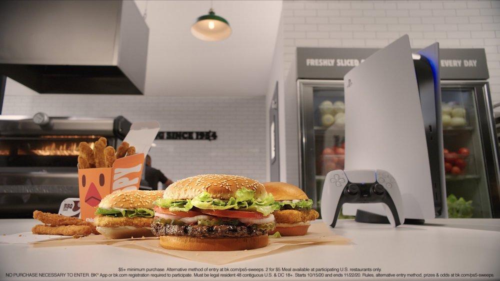 Burger King menu items next to a Sony PlayStation 5