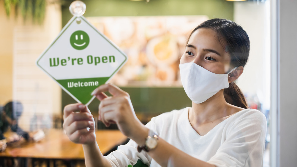 Woman with mask at restaurant