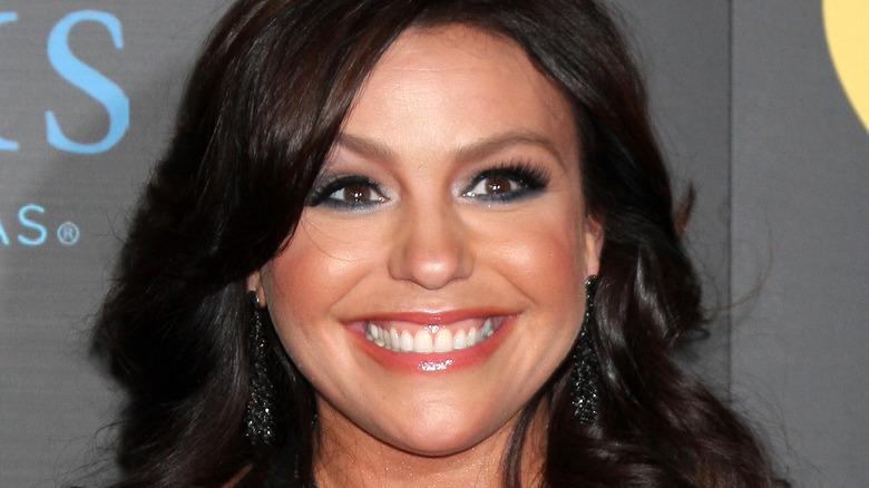 Rachael Ray smiles with black earrings