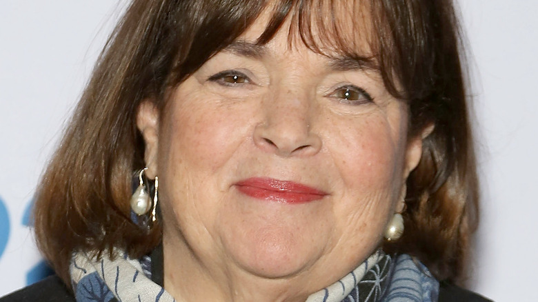 Ina Garten wearing black jacket and multi-colored scarf