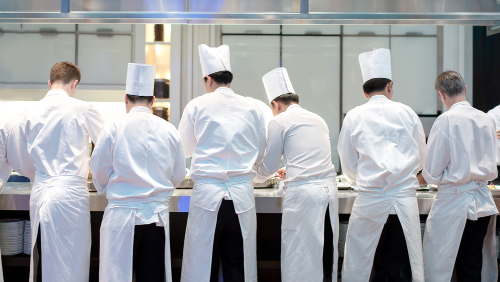 chefs working side by side