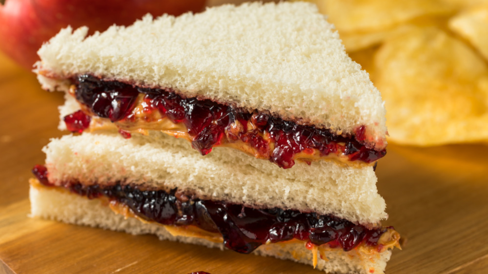 peanut butter and jelly sandwich cut in triangles with white bread