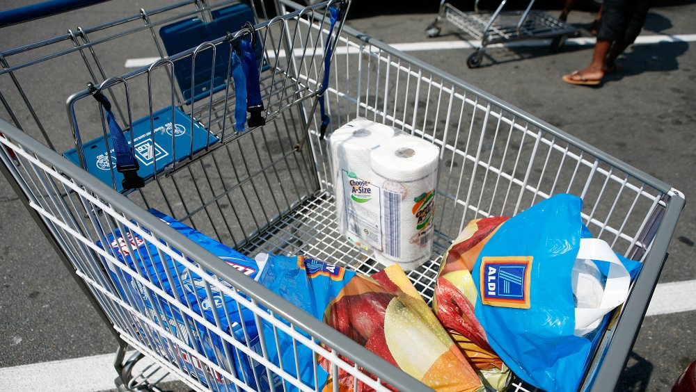 Shopping cart full of Aldi groceries