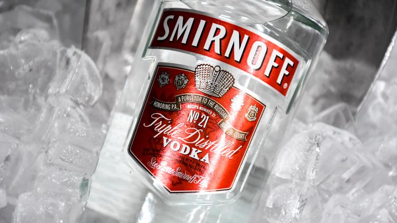 Smirnoff bottle in ice