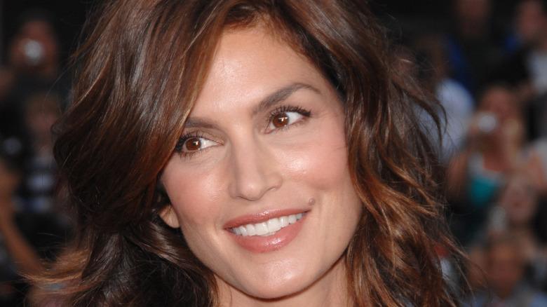 Cindy Crawford smiling at event