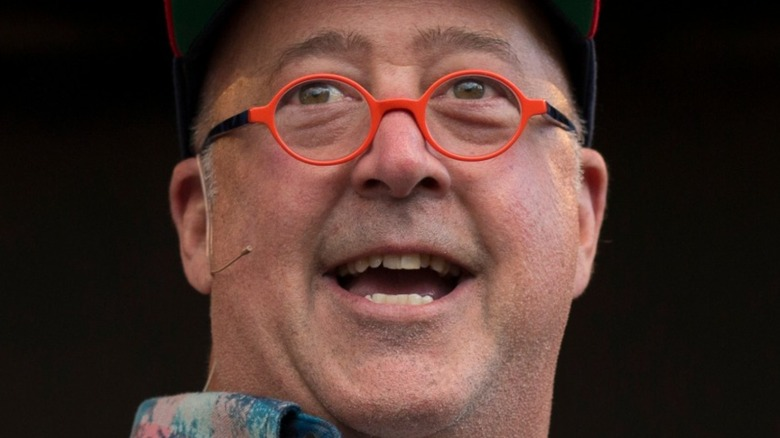 Andrew ZImmern in orange glasses